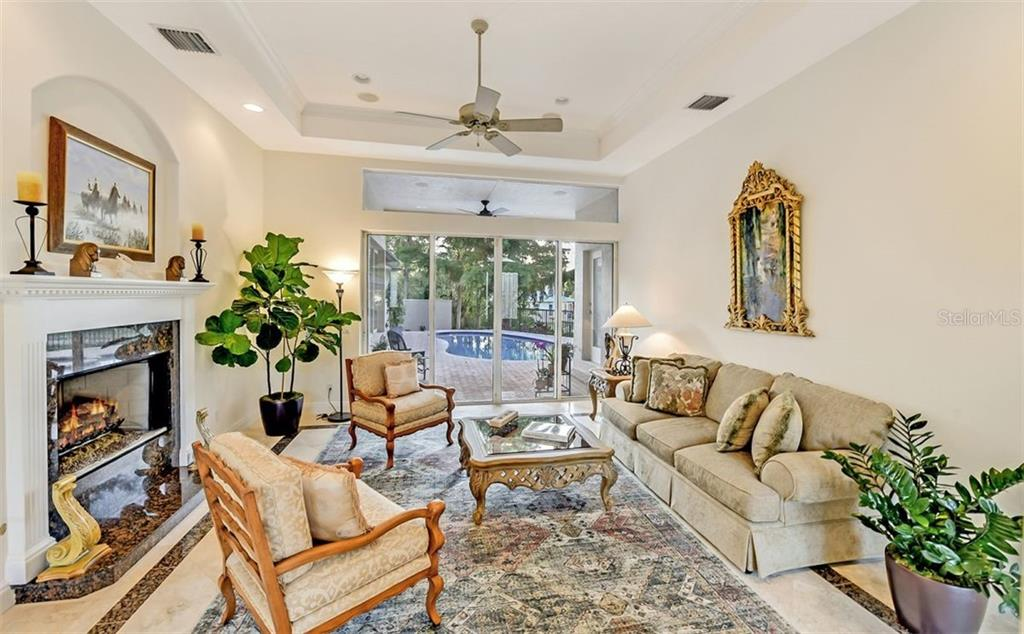 Lovely space with high ceilings & walls of windows to your terrace - Single Family Home for sale at 501 Cutter Ln, Longboat Key, FL 34228 - MLS Number is A4480484