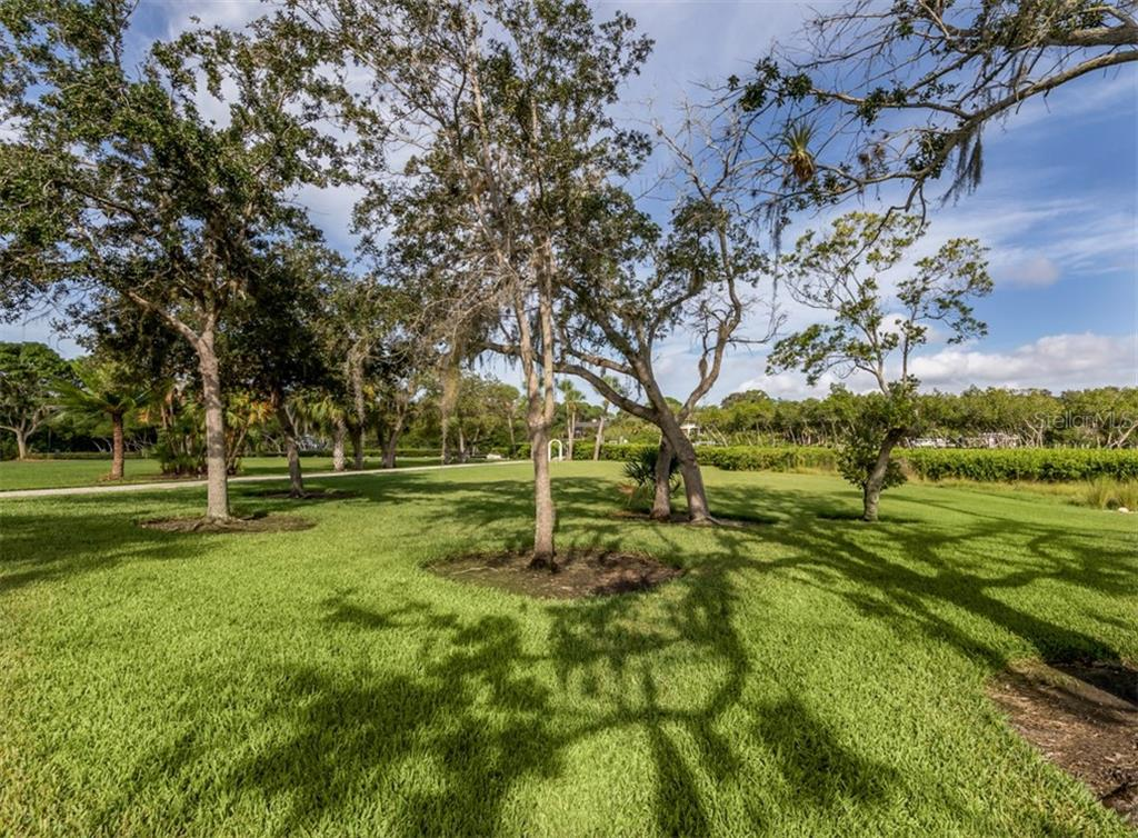 Manicured Yard looking towards Forked Creek - Single Family Home for sale at 1395 Bayshore Dr, Englewood, FL 34223 - MLS Number is A4480508
