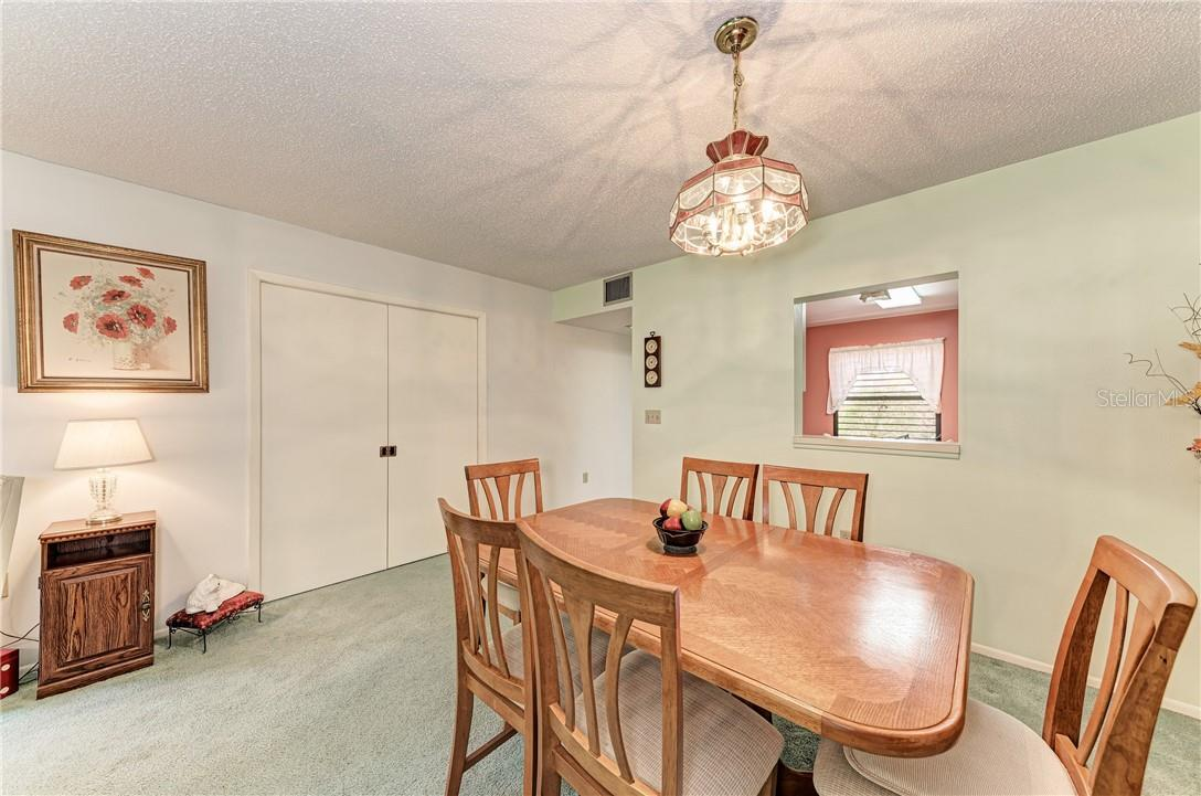 Convenient pocket doors for closing den from living room - Condo for sale at 814 Spring Lakes Blvd #814, Bradenton, FL 34210 - MLS Number is A4480798