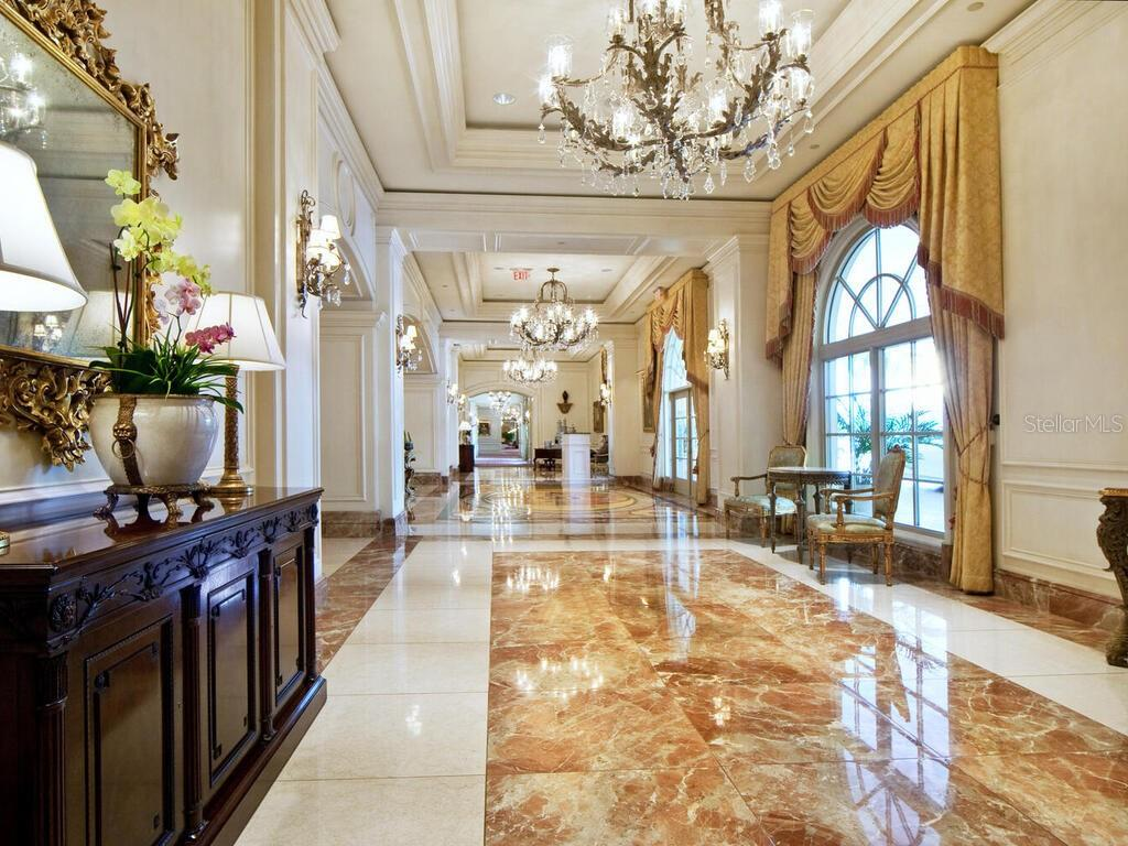 Enter via The Residences' private lobby downstairs or via the main hotel lobby, shown here. - Condo for sale at 1111 Ritz Carlton Dr #1506, Sarasota, FL 34236 - MLS Number is A4480943