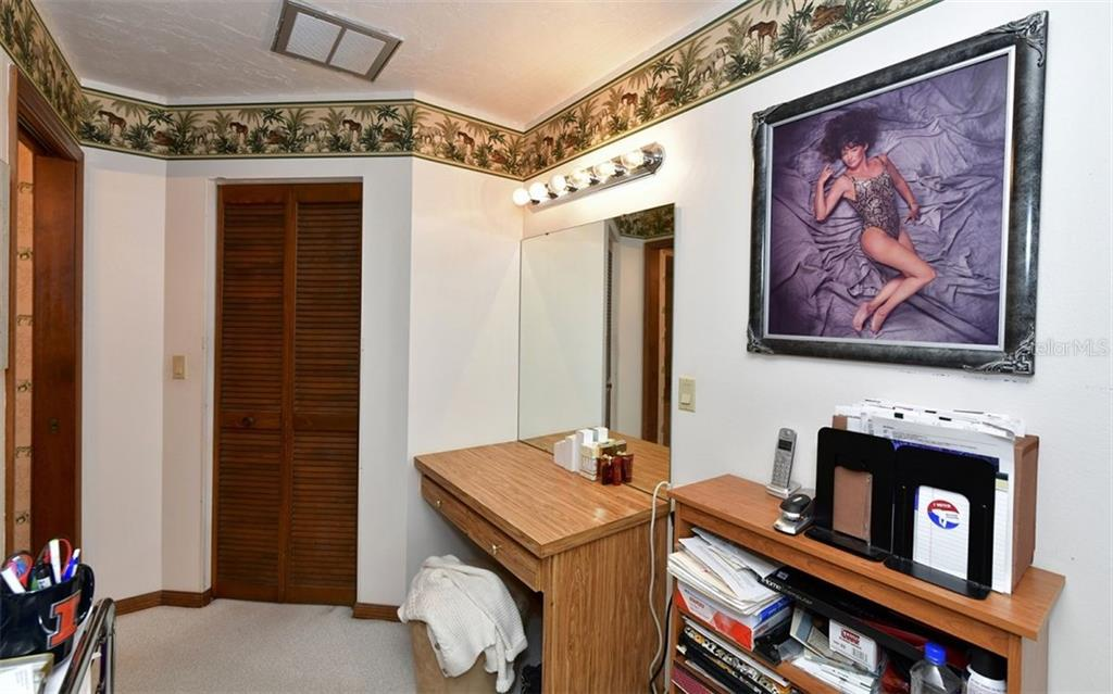 Vanity area in master suite. Bi-fold doors in picture open to walk in closet - Single Family Home for sale at 9219 Bimini Dr, Bradenton, FL 34210 - MLS Number is A4483083