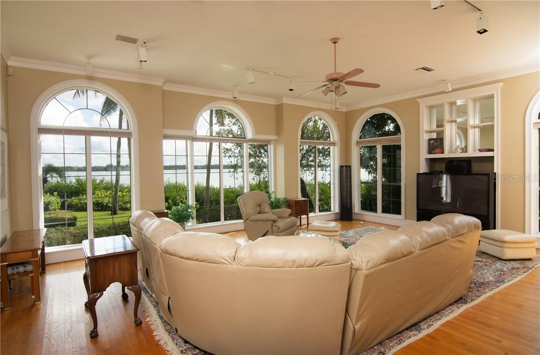 Family room. - Single Family Home for sale at Address Withheld, Sarasota, FL 34242 - MLS Number is A4483403
