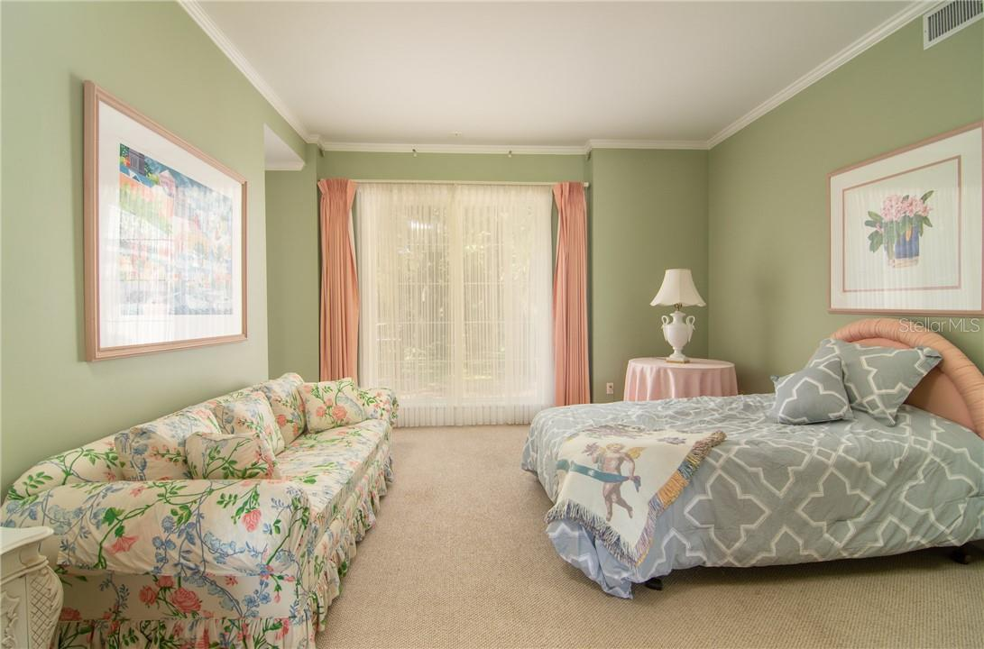Bedroom looking out to the front gardens. - Single Family Home for sale at Address Withheld, Sarasota, FL 34242 - MLS Number is A4483403