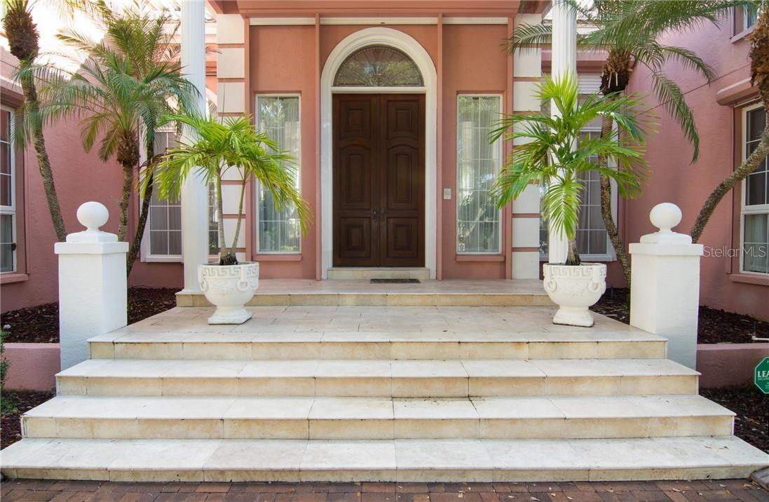 Front entry. - Single Family Home for sale at Address Withheld, Sarasota, FL 34242 - MLS Number is A4483403