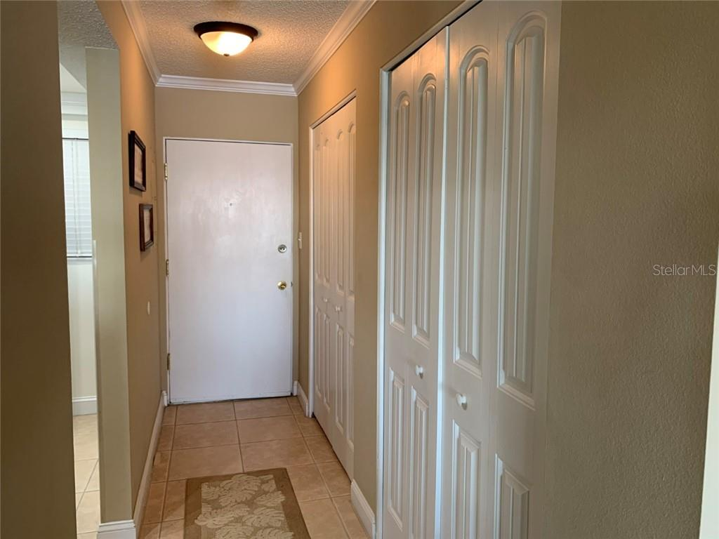 Entrance with 2 large closets - Condo for sale at 9011 Midnight Pass Rd #328, Sarasota, FL 34242 - MLS Number is A4483601