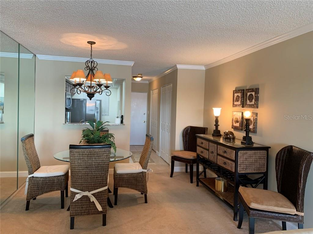 Dining and Entrance - Condo for sale at 9011 Midnight Pass Rd #328, Sarasota, FL 34242 - MLS Number is A4483601