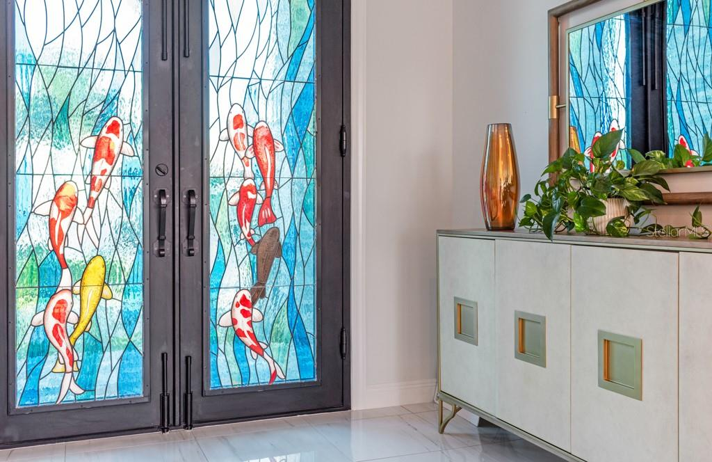 Custom Double Glass Front Door - Single Family Home for sale at 121 Seagull Ln, Sarasota, FL 34236 - MLS Number is A4483951