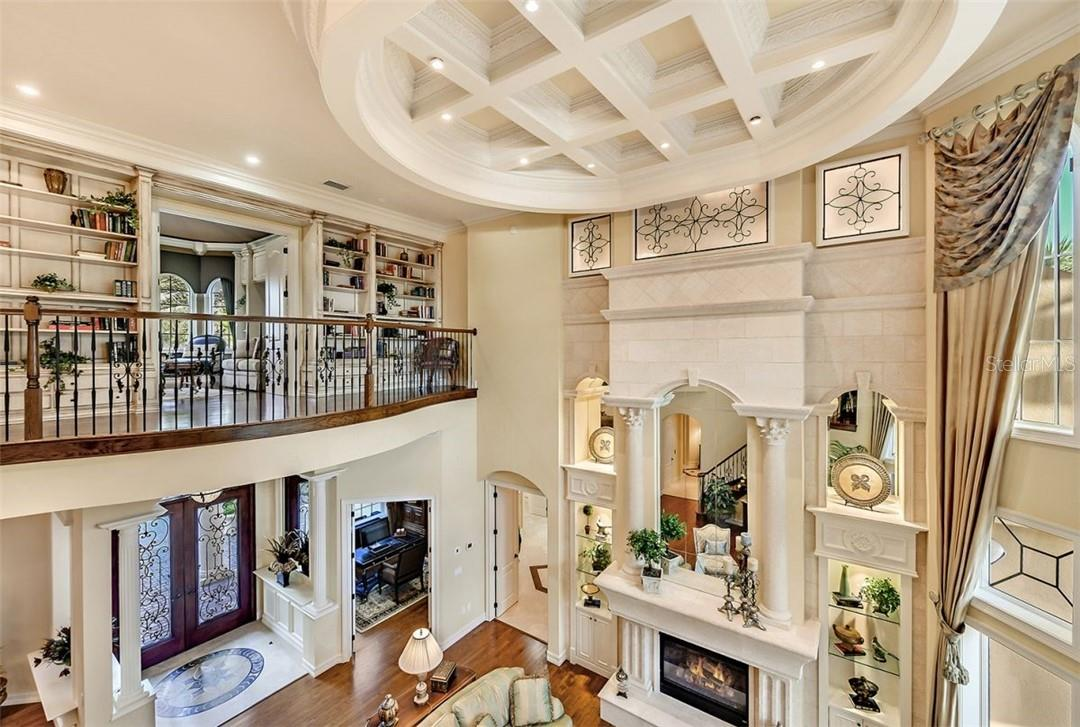 A great vantage point from the top of the staircase, look at that relaxing library & den - Single Family Home for sale at 8263 Archers Ct, Sarasota, FL 34240 - MLS Number is A4483993