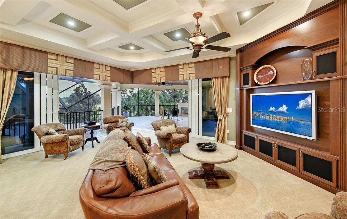 Large comfortable sofa, chairs, to enjoy many shows or games, not again the detail to the  coffered ceiling & custom cornices w/ draperies. - Single Family Home for sale at 8263 Archers Ct, Sarasota, FL 34240 - MLS Number is A4483993