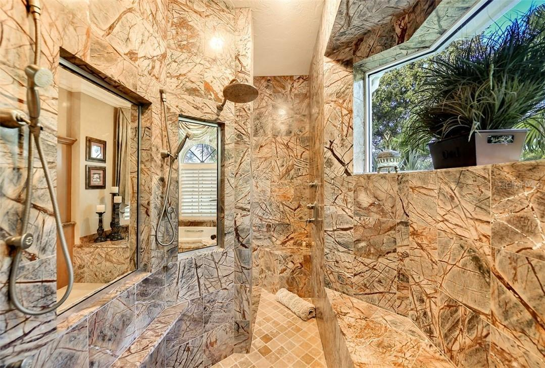 You could even bathe your pooches in here, very oversized with a wide seat & great use of stone & granite - Single Family Home for sale at 8263 Archers Ct, Sarasota, FL 34240 - MLS Number is A4483993