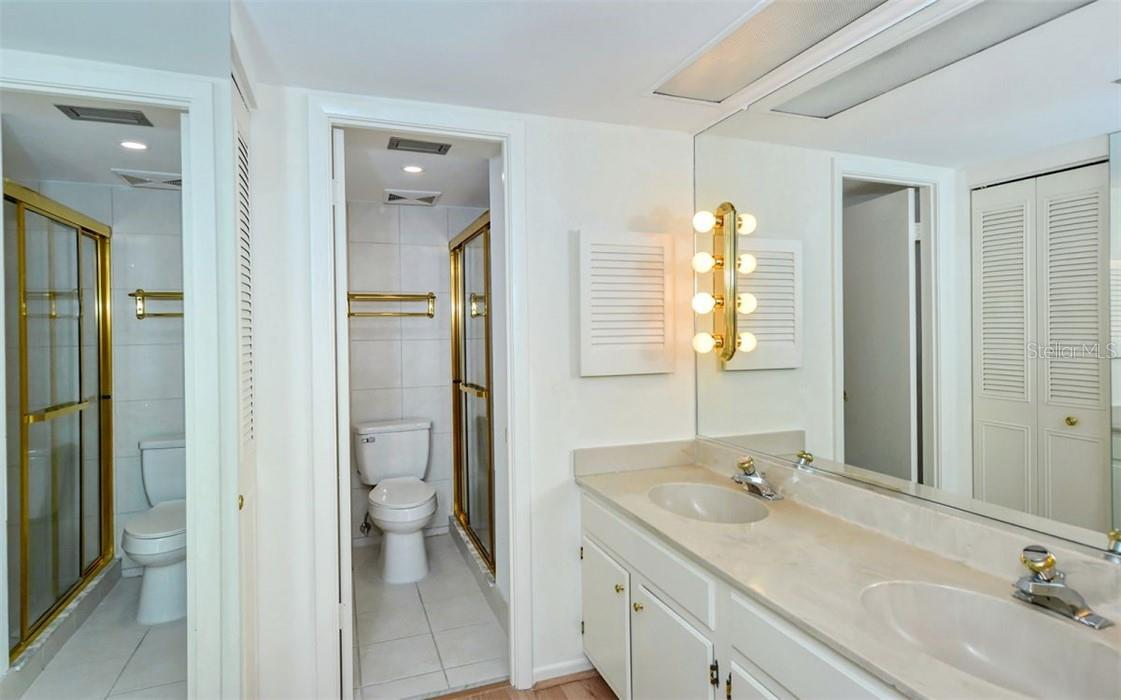 En Suite Bathroom with his and hers walk-in closets. - Condo for sale at 707 S Gulfstream Ave #1002, Sarasota, FL 34236 - MLS Number is A4484781