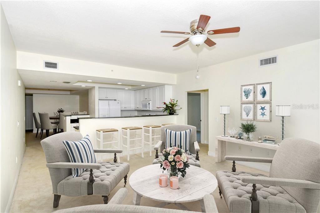 Living room with a great view - Condo for sale at 800 N Tamiami Trl #1007, Sarasota, FL 34236 - MLS Number is A4485565