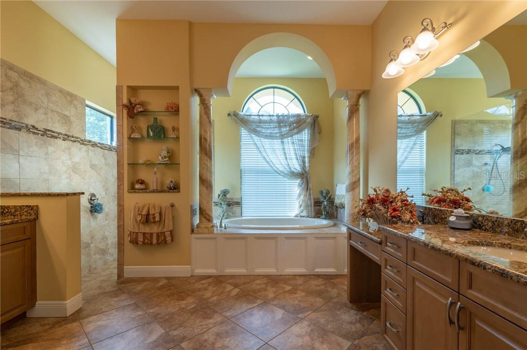 The Owners' Suite Bathroom is very large with a soaking tub, walk-in shower, two separate vanities and a separate water closet with a bidet. - Single Family Home for sale at 11720 Rive Isle Run, Parrish, FL 34219 - MLS Number is A4486302