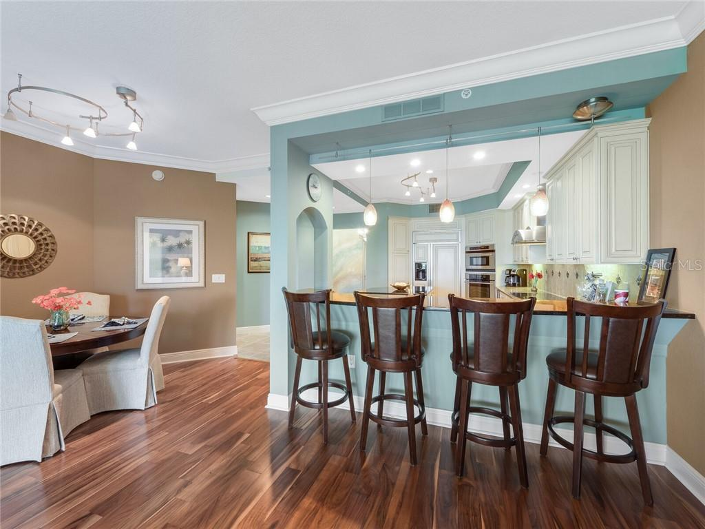 This kitchen takes center stage creating a  a space where people come together. - Condo for sale at 14021 Bellagio Way #407, Osprey, FL 34229 - MLS Number is A4487552