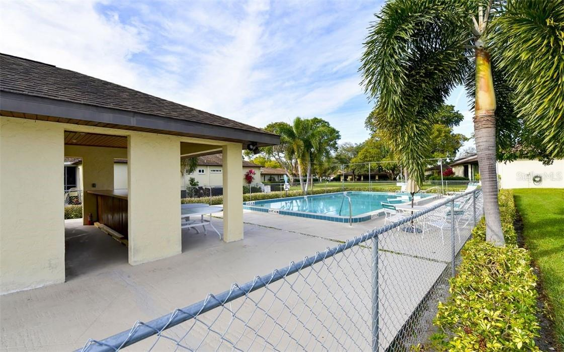 Community pool & clubhouse - Villa for sale at 3314 Vivienda Blvd, Bradenton, FL 34207 - MLS Number is A4488348