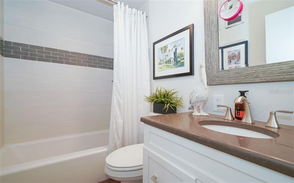 Full bath off the hall - Condo for sale at 761 John Ringling Blvd #28, Sarasota, FL 34236 - MLS Number is A4490945