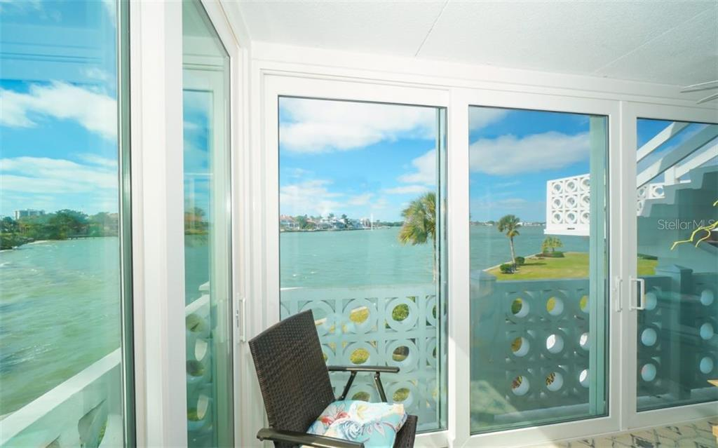 View from the porch in two directions - Condo for sale at 761 John Ringling Blvd #28, Sarasota, FL 34236 - MLS Number is A4490945