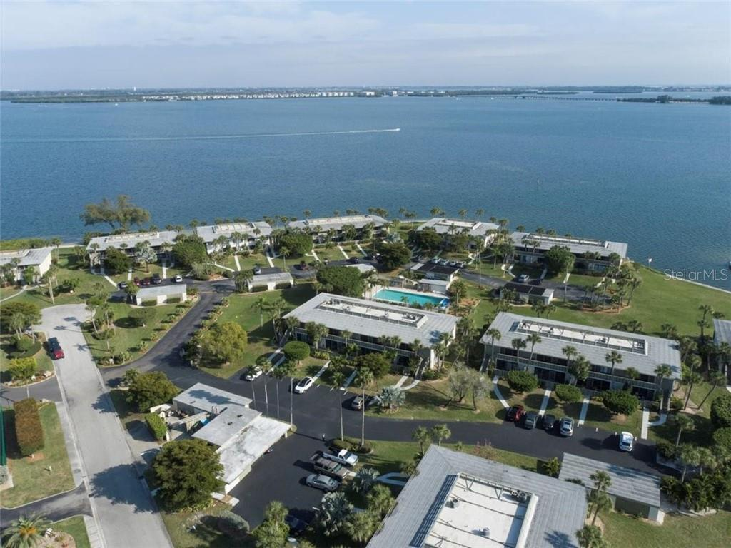 This condo overlooks the pool and has peaks of the bay and canal - Condo for sale at 6500 Flotilla Dr #157, Holmes Beach, FL 34217 - MLS Number is A4492035