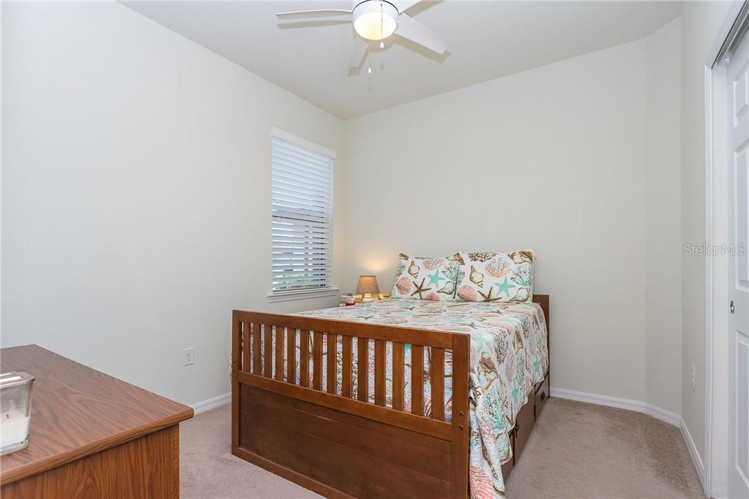 Bedroom 2 in this split plan offers your guests additional privacy - Villa for sale at 13883 Botteri St, Venice, FL 34293 - MLS Number is A4493523