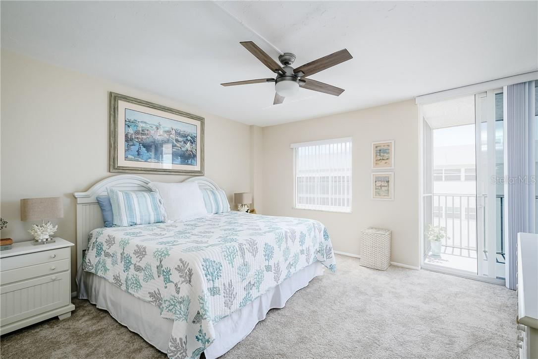 Guest Bedroom with Sliders to Balcony - Condo for sale at 6300 Midnight Pass Rd #701, Sarasota, FL 34242 - MLS Number is A4496847