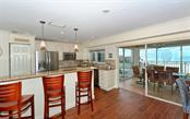 Kitchen/Dining with sliders to balcony - Condo for sale at 5830 Midnight Pass Rd #504, Sarasota, FL 34242 - MLS Number is A4166623