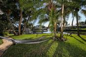 Private dock with power, water, and 10,000 lb boat lift.  Don't forget the hammock for a nap or a good read! - Single Family Home for sale at 5281 Cape Leyte Way, Sarasota, FL 34242 - MLS Number is A4171478