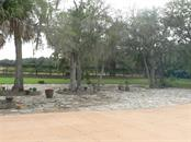 View from Driveway to Street - Single Family Home for sale at 16314 Golf Course Rd, Parrish, FL 34219 - MLS Number is A4171555