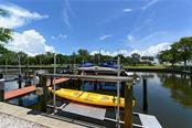Your assigned boat dock and lift in the Weston Pointe Marina - Single Family Home for sale at 602 Weston Pointe Ct, Longboat Key, FL 34228 - MLS Number is A4178531