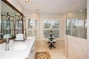 Dual vanity master suite bath with walk-in shower, plantation shutters and recessed lighting. - Single Family Home for sale at 3765 Beneva Oaks Blvd, Sarasota, FL 34238 - MLS Number is A4185879