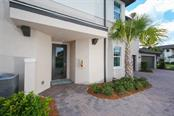 Front entry. - Condo for sale at 1255 Riverscape St #n/A, Bradenton, FL 34208 - MLS Number is A4186832