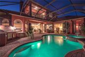Evening Pool View with Slider Doors Open - Single Family Home for sale at 370 Highland Shores Dr, Ellenton, FL 34222 - MLS Number is A4188456