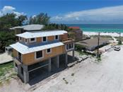 Single Family Home for sale at 105 34th St, Holmes Beach, FL 34217 - MLS Number is A4188488