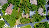 This almost 1/2 acre lot borders open county land that will never be developed. It's like living in the country right in the heart os Sarasota! - Single Family Home for sale at 4594 Trails Dr, Sarasota, FL 34232 - MLS Number is A4188494