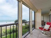 Beach and Gulf of Mexico views from screened balcony - Condo for sale at 19 Whispering Sands Dr #205, Sarasota, FL 34242 - MLS Number is A4189914
