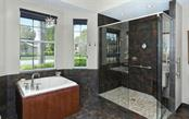 Oversized shower enhances the master bath. - Single Family Home for sale at 8747 Grey Oaks Ave, Sarasota, FL 34238 - MLS Number is A4195019
