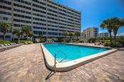 Gulf side swimming pool and paver brick sun deck - Condo for sale at 6140 Midnight Pass Rd #c-9, Sarasota, FL 34242 - MLS Number is A4195879