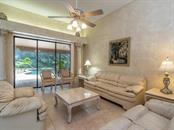 Living Room - Single Family Home for sale at 7520 Weeping Willow Dr, Sarasota, FL 34241 - MLS Number is A4196497