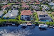 Room for a 65 foot yacht! also has a floating jet ski dock and 12,000 lb boat lift. Direct Canal .. no fixed bridges or lock to the gulf. - Single Family Home for sale at 548 Fore Dr, Bradenton, FL 34208 - MLS Number is A4196590