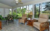 This tastefully designed lanai has been enclosed with hurricane impact windows, offers a private water view with tropical landscaping and adds an additional 240+ sq ft to the already spacious home. - Single Family Home for sale at 9571 Knightsbridge Cir, Sarasota, FL 34238 - MLS Number is A4197972