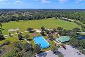 Nearby Adventure Park with covered picnic tables, restrooms, roller hockey, basketball, covered play area, soccer, and dog park. - Single Family Home for sale at 6408 Indigo Bunting Pl, Lakewood Ranch, FL 34202 - MLS Number is A4199746