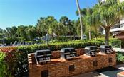 Community BBQ patio - Condo for sale at 5855 Midnight Pass Rd #328, Sarasota, FL 34242 - MLS Number is A4200358