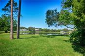 large back yard overlooking the beautiful lake - Single Family Home for sale at 7529 Weeping Willow Blvd, Sarasota, FL 34241 - MLS Number is A4201676