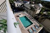 Looking at the pool from the terrace - Condo for sale at 1771 Ringling Blvd #609, Sarasota, FL 34236 - MLS Number is A4201774