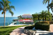 Single Family Home for sale at 590 Golf Links Ln, Longboat Key, FL 34228 - MLS Number is A4203940