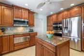 Kitchen with stainless steel appliances - Single Family Home for sale at 5439 Azure Way, Sarasota, FL 34242 - MLS Number is A4203969