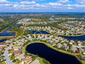 Lots of lakes and opens spaces in Greyhawk Landing - Single Family Home for sale at 12071 Aster Ave, Bradenton, FL 34212 - MLS Number is A4205214