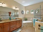 Beautifully tiled walk in shower & garden tub makes for a relaxing end of the day or a refreshing start to your morning! - Single Family Home for sale at 6601 Horned Owl Pl, Sarasota, FL 34241 - MLS Number is A4205612