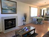 Open plan with vaulted ceilings and wood laminate flooring in the living and dining rooms. - Condo for sale at 3858 59th Ave W #4178, Bradenton, FL 34210 - MLS Number is A4206819