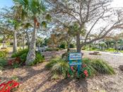 Entryway/island to Baypoint - Single Family Home for sale at 411 Lyons Bay Rd, Nokomis, FL 34275 - MLS Number is A4209146