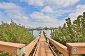 #6 Dock and slip deeded to unit - Condo for sale at 1310 Old Stickney Point Rd #e21, Sarasota, FL 34242 - MLS Number is A4209502